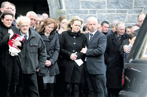 Friends and relatives of Deirdre McCarthy outside St John the Baptist Church, Ballyvaughan, Co Clare, at her funeral yesterday