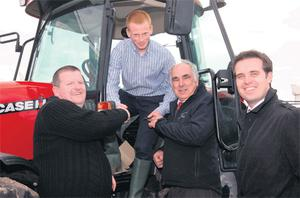 Cian O'Flynn, Carrigaline, Co Cork (second from left), collects the keys of the Case JX90, which he won in the recent Farming Independent competition, from Farming Independent editor Declan O'Brien (left), Springmount Tractors' Alfie Spencer (second from right) and Irish Independent marketing manager Geoff Lyons