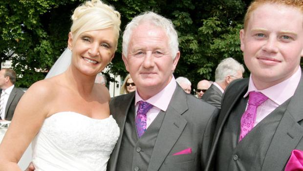 HAPPY DAY: Graham Turley and Suzanne Tormey, with Graham's son Cathal, right, at the wedding yesterday. Photo: Gerry Money