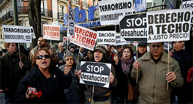 Members of the Mortgage Victims' Platform (PAH) protest in front of the HQ of Spain's centreright People's Party in Madrid yesterday