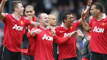 Manchester United players celebrate winning the Premier League at Ewood Park yesterday afternoon