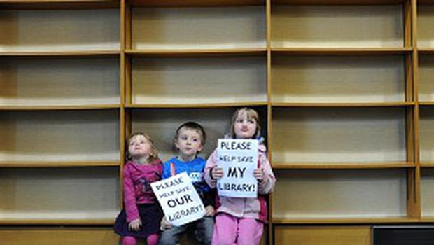 Three children join the protest to save the library