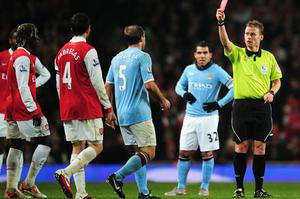 Referee Mike Jones sent off Pablo Zabaleta of Manchester City (5) and Bacary Sagna of Arsenal during last night's match. Photo: Getty Images