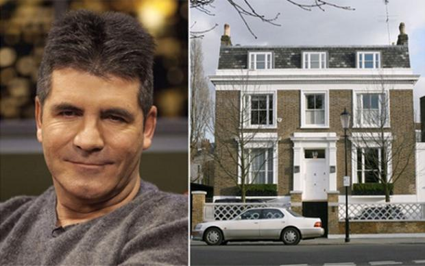 Simon Cowell was watching TV in his bedroom when he heard a 'loud bang' coming from his bathroom