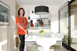 Tonya in the dining area of her house in south Co Dublin. The extendable table is from BoConcept in the Beacon South Quarter in Sandyford. The door opens on to a balcony to the front of the house.