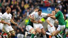 England's Brad Barritt is tackled by Ireland's Jonathan Sexton (right)