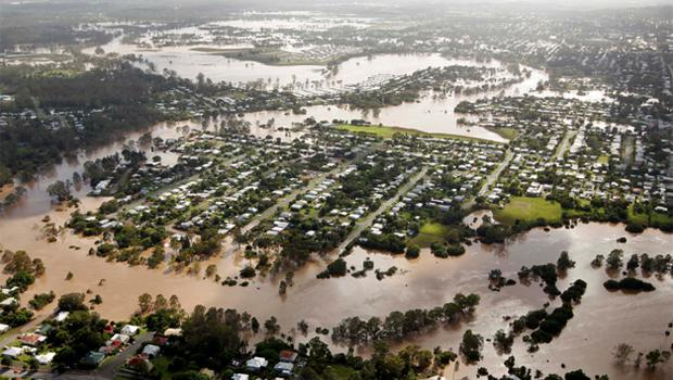 The Brisbane River breaks its banks to flood residential areas west of Brisbane. Photo: Reuters