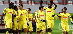 Anzhi Makhachkala's Lacina Traore (2dn R) celebrates with teammates after he scored against Liverpool during their Europa League Group A soccer match at Lokomotiv stadium in Moscow November 8, 2012.  REUTERS/Grigory Dukor (RUSSIA  - Tags: SPORT SOCCER)