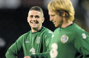 Robbie Brady shares a joke with Paul McShane during the Irish training session at Craven Cottage last night - Brady will make his Irish debut against Oman tonight