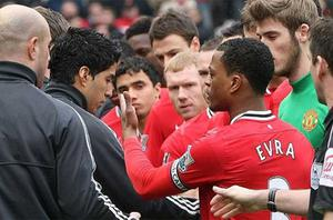 Hands away: Luis Suarez refused to shake hands with Patrice Evra ahead Manchester United's match with Liverpool at Old Trafford. Photo: Getty Images