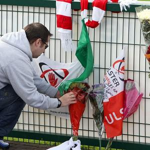 Flowers are laid at Ravenhill Grounds in memory of young rugby star Nevin Spence, who died when he fell into a slurry pit