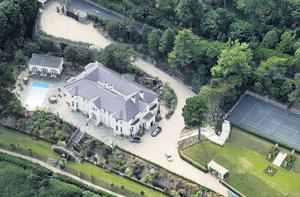 QUIET DESPERATION: The home of Brian and Mary Pat O'Donnell on Vico Road in Killiney, featuring gardens and tennis court