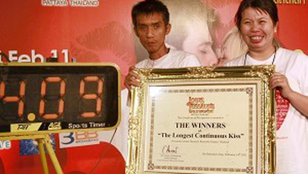 Laksana Tiranarat and husband Ekkachai pose with a certificate after winning the World's Longest Continuous Kiss contest (AP)