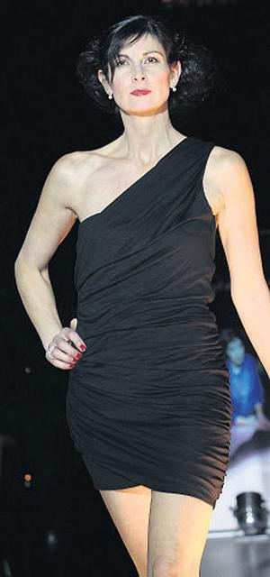 Sylvia Myers wears a black dress from Couture Boutique