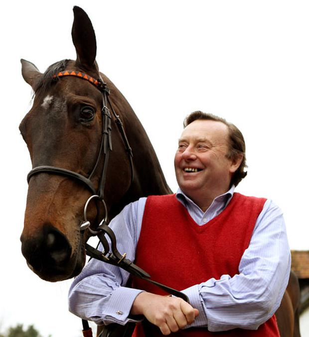 National Hunt Trainer Nicky Henderson with Long Run at Severn Barrows stables on February 28, 2012 in Lambourn, England. (Photo by Scott Heavey/Getty Images)