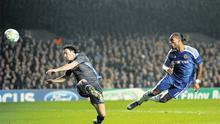 Didier Drogba scores Chelsea's first goal past Napoli's Salvatore Aronica