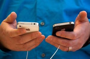 Invites to the event read  'Let's talk iPhone'. Photo: Getty Images