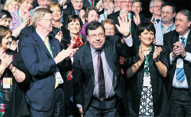 Former Taoiseach Brian Cowen, centre, gets a huge round of applause as he is introduced at the Fianna Fail Ard Fheis at the weekend in the RDS, Dublin