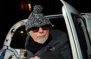 Former British pop star Gary Glitter returns to his home in London. Glitter was arrested on Sunday as part of an investigation into allegations of child sex abuse by the late BBC presenter Jimmy Savile, the BBC said. Photo: Reuters