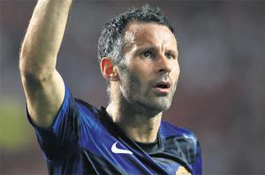 Ryan Giggs' 27th Champions League goal helps Manchester United escape with a point against Benfica