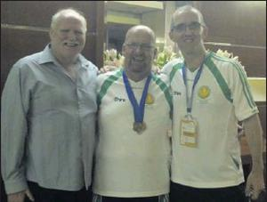 Skerries athlete Peter Heffernan, proudly displaying the two bronze medals he won in the pool at the European Transplant and Dialysis Games, with Team Captain Harry Doyle from Baldoyle and Team Manager Colin White from Balbriggan.