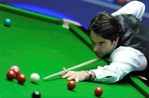 Ronnie O'Sullivan at the table during his first round match at the World Snooker Championships. Photo: PA