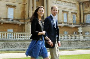 Prince William and Catherine, Duchess of Cambridge, walking in the gardens of Buckingham Palace on Saturday