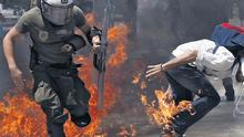 Rioters use firebombs and stones against the police