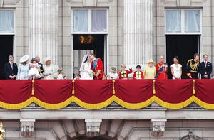 Their Royal Highnesses Prince William , Duke of Cambridge and Catherine, Duchess of Cambridge kiss on the balcony at Buckingham Palace