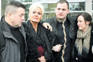 Rape victim Fiona Doyle being consoled by her husband Jim (left) and family and friends outside court