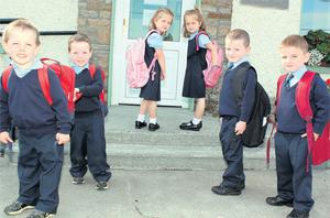 The three sets of twins, Shane and Conor Moloney, Shauna and Louise Callaghan, and Shane and James Cunningham, on their first day at Loughnavalley National School yesterday