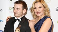 Martin McCann who won the 'Actor in a Lead Role - Film' award poses with Kim Cattrall