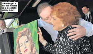 Kenneth gets a kiss from Maureen as he presents his painting to her.