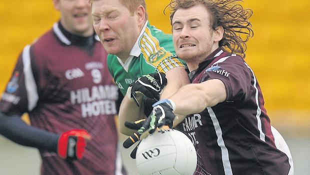 Offaly's Alan Mulhall challenges Westmeath's Kieran Sheridan