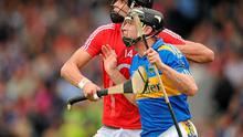 Cork's Aisake Ó hAilpín and Tipperary's Paul Curran tussle during last year's Munster SHC clash which Cork won.