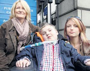 Cullen Kennedy (10), who suffered injuries in a car crash in 2008 that left him a quadriplegic, was awarded €11.5m at the High Court yesterday. With him are his grandmother Monica Kennedy, left, and his mother Margaret Kennedy, right.