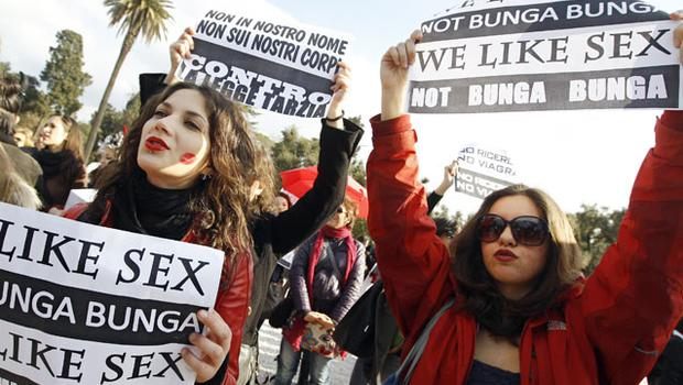 Women hold placards during a demonstration against Italy' s Prime Minister Silvio Berlusconi in downtown Rome. Photo: Reuters