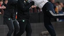 Celtic manager Neil Lennon (centre) is attacked by a spectator at Tynecastle last night while his assistant Alan Thompson attempts to intervene