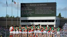 The Mayo team stand for the national anthem before the game