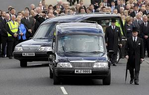 Hearses carrying the coffins of Nevin Spence, his brother Graham and father Noel leave Ballynahinch Baptist Church