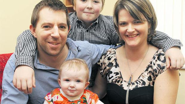 Bundle of joy: Barry Keohane and his partner Fran with their two children Ben and Asha. Photo: Patrick Hogan
