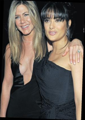 Jennifer Aniston in her daring Tom Ford frock, with Salma Hayek.