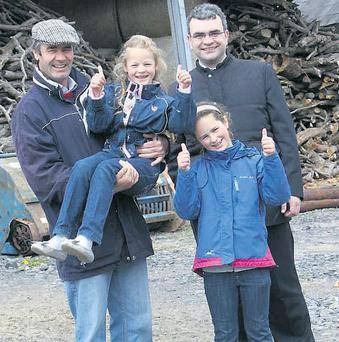THUMBS UP: (from left) Farmer John Duffy, Nutstown, Co Dublin, and his children Maria and Katherine give their approval to the farm safety walk attended by Minister for Labour Affairs Dara Calleary. The walk was organised to identify the potential hazards that exist on farms.