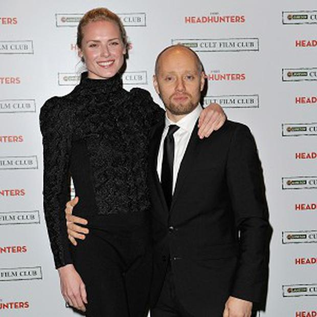 Aksel Hennie, pictured with co-star Synnove Lund, would love Mark Wahlberg to play his character in a remake of Headhunters