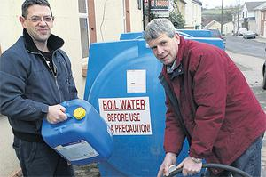 David Winters (left) and John Morgan fill up their containers at the Naul,Co Dublin, yesterday