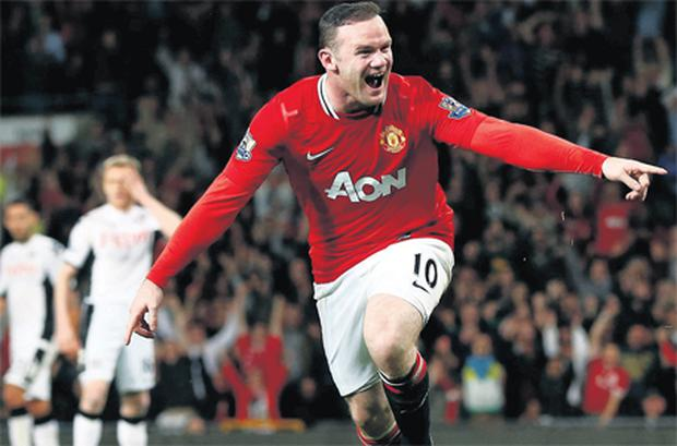 Wayne Rooney scores the game's only goal as Manchester United hold on for a nervous win over Fulham