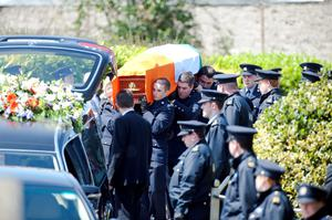 Colleagues carry the remains of Adrian Hickey at his funeral in Blarney yest.NO BYLINE