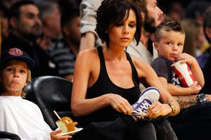 Sussed: with three young sons to look after, Victoria Beckham – with Romeo (left) and Cruz (right) – knows all about the travails of rearing boys. Photo: Getty Images
