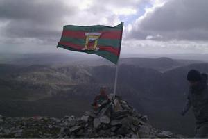 The Mayo flag at the top of Mount Errigal.