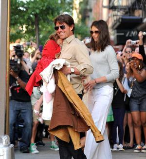 NEW YORK - MAY 25:  Suri Cruise, Tom Cruise and Katie Holmes seen on the streets of Manhattan on May 25, 2010 in New York City.  (Photo by James Devaney/WireImage)